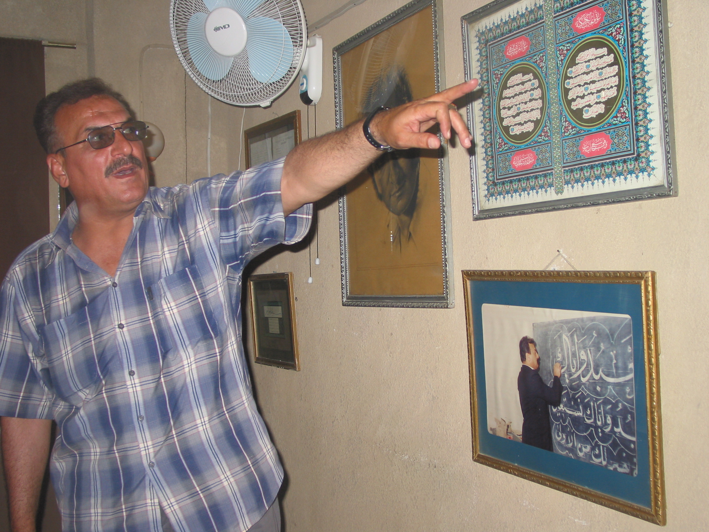 Celebrated calligrapher Abbas Baghdadi displays his work in his home in the Baghdad suburbs.