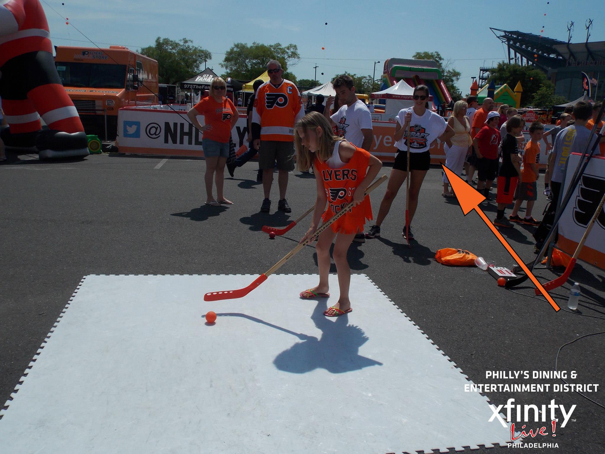 Me at NHL Draft Summer 2014 operating kids' hockey skills activity.