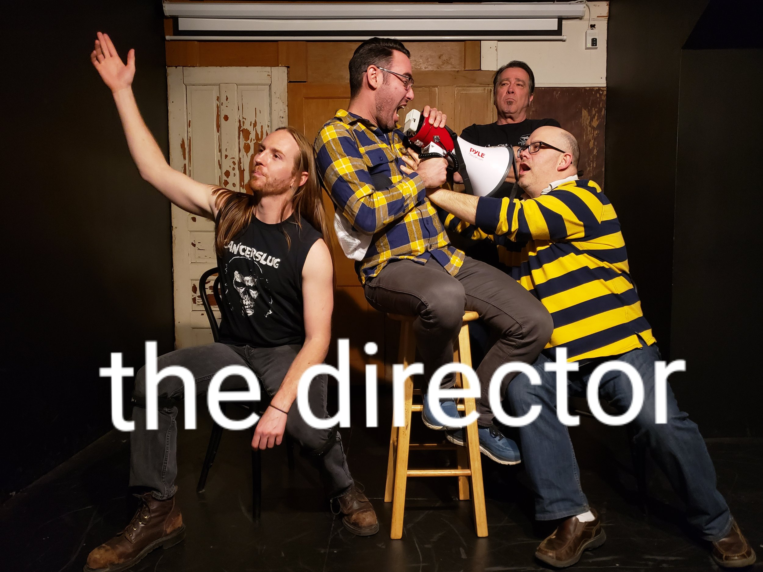 """The Director is a chaotic show loosely narrated and edited by a """"director"""" while a camera streams the action onto a screen behind the stage giving the audience multiple perspectives of the scene. Experienced players develop the narrative while audience members are invited to jump into the scenes to expand the cast. As the camera follows the actors the stage expands to anywhere inside or outside of the theater."""