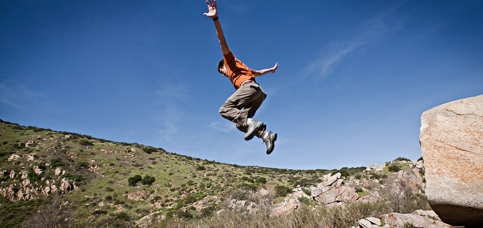 Free runner jumping of a huge rock. san diego commercial photography, san diego commercial photographer, southern California commercial photographer, California commercial photographer