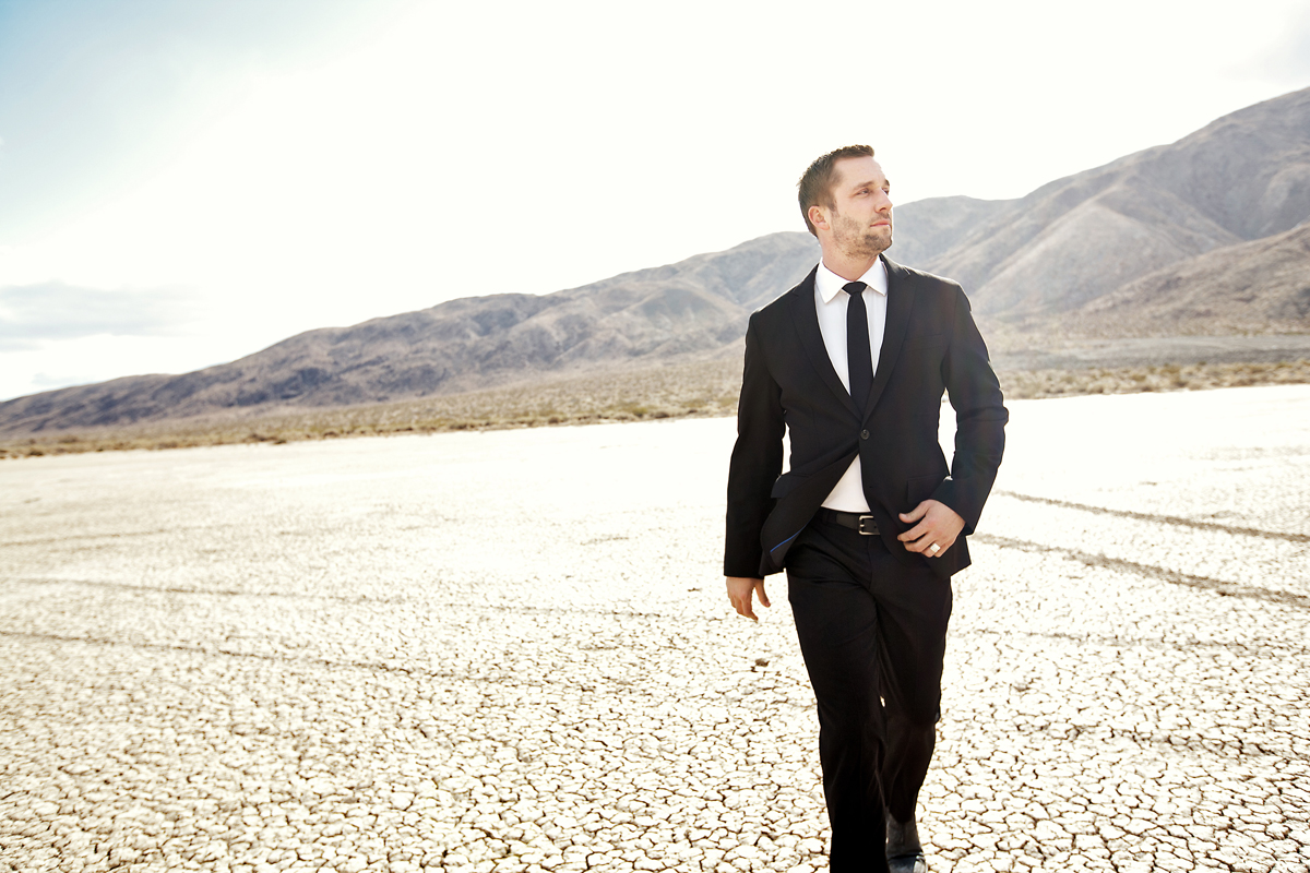 Musician walking in the desert. san diego commercial photographer, san diego fashion photographer, san diego fashion photography, southern fashion photographer, California fashion photographer