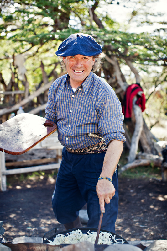Portrait of a gaucho in Patagonia cooking over a fire. san diego travel photography, san diego travel photographer, southern California travel photographer, California travel photographer