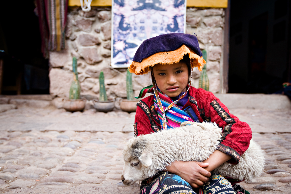 Cute photo of a Peruvian child holding a lamb. san diego travel photography, san diego travel photographer, southern California travel photographer, California travel photographer