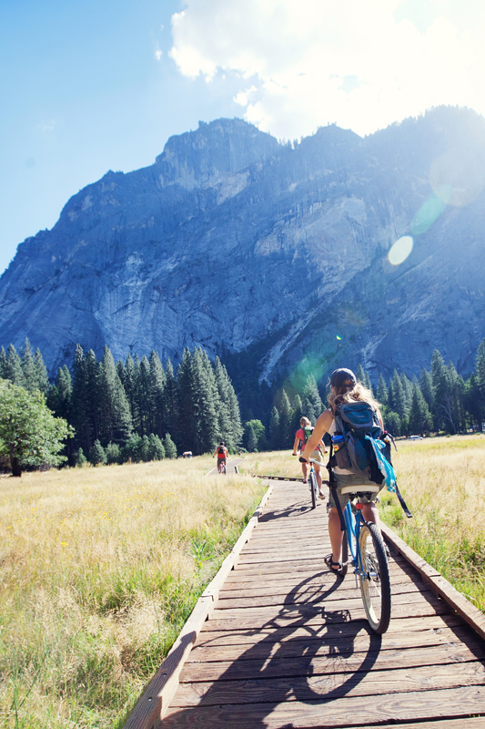 Friends cycling through Yosemite Valley