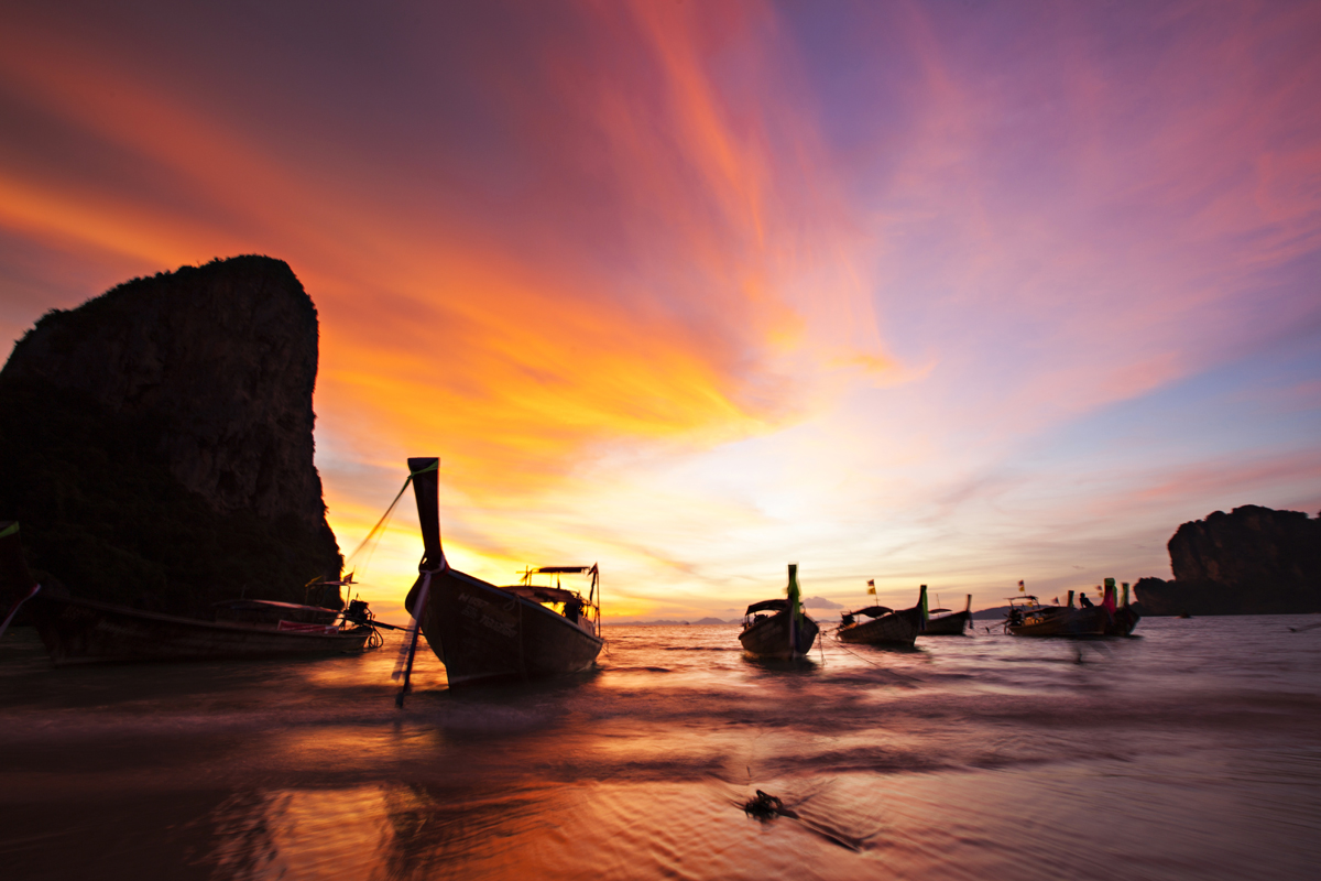 boats at sunset on railay beach, thailand. san diego commercial photography, san diego commercial photographer, southern California commercial photographer, California commercial photographer