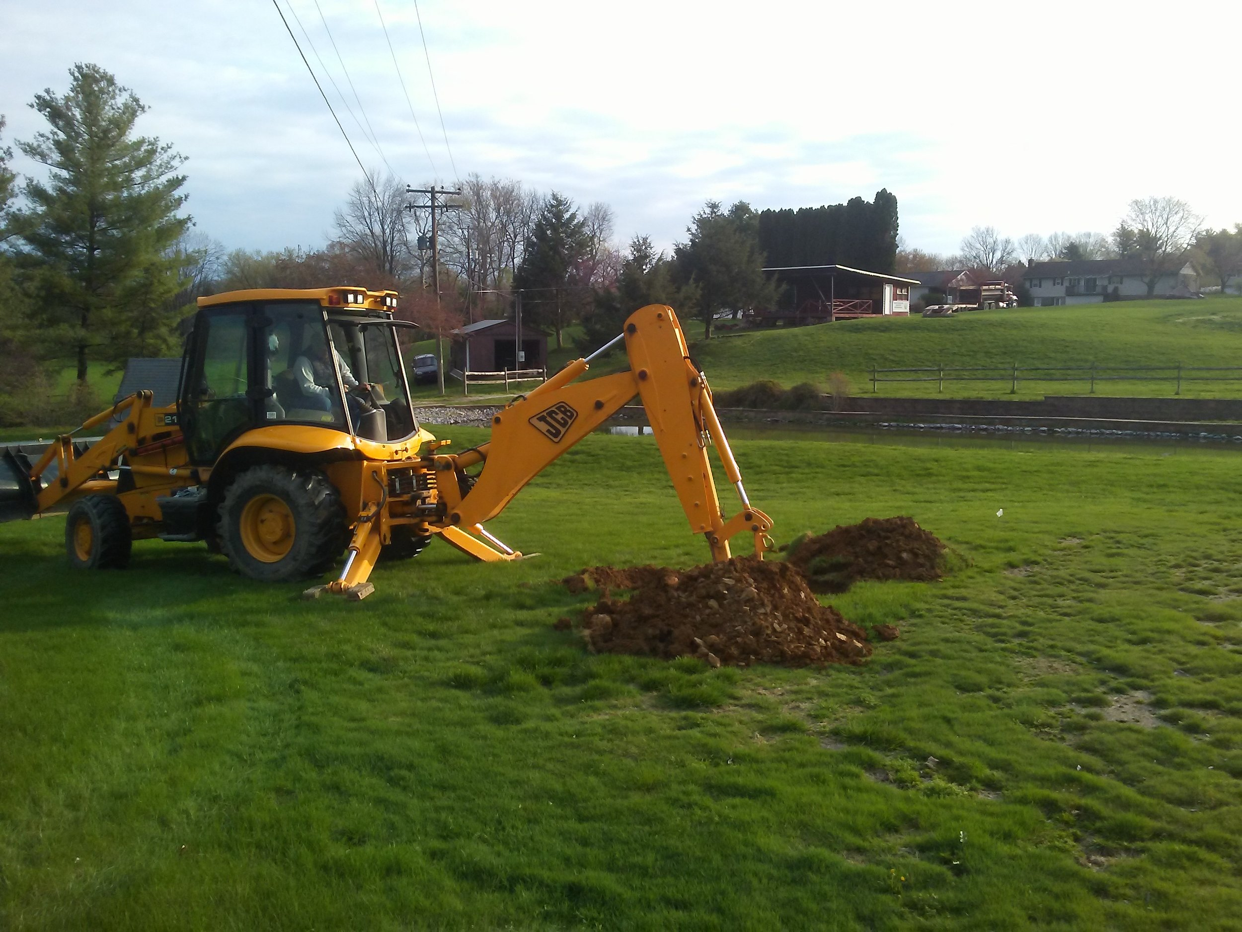 backhoe and clubhouse.jpg