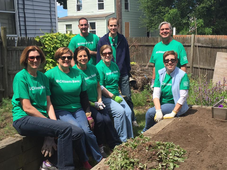 A group of volunteers from Citizens Bank working in our community garden!