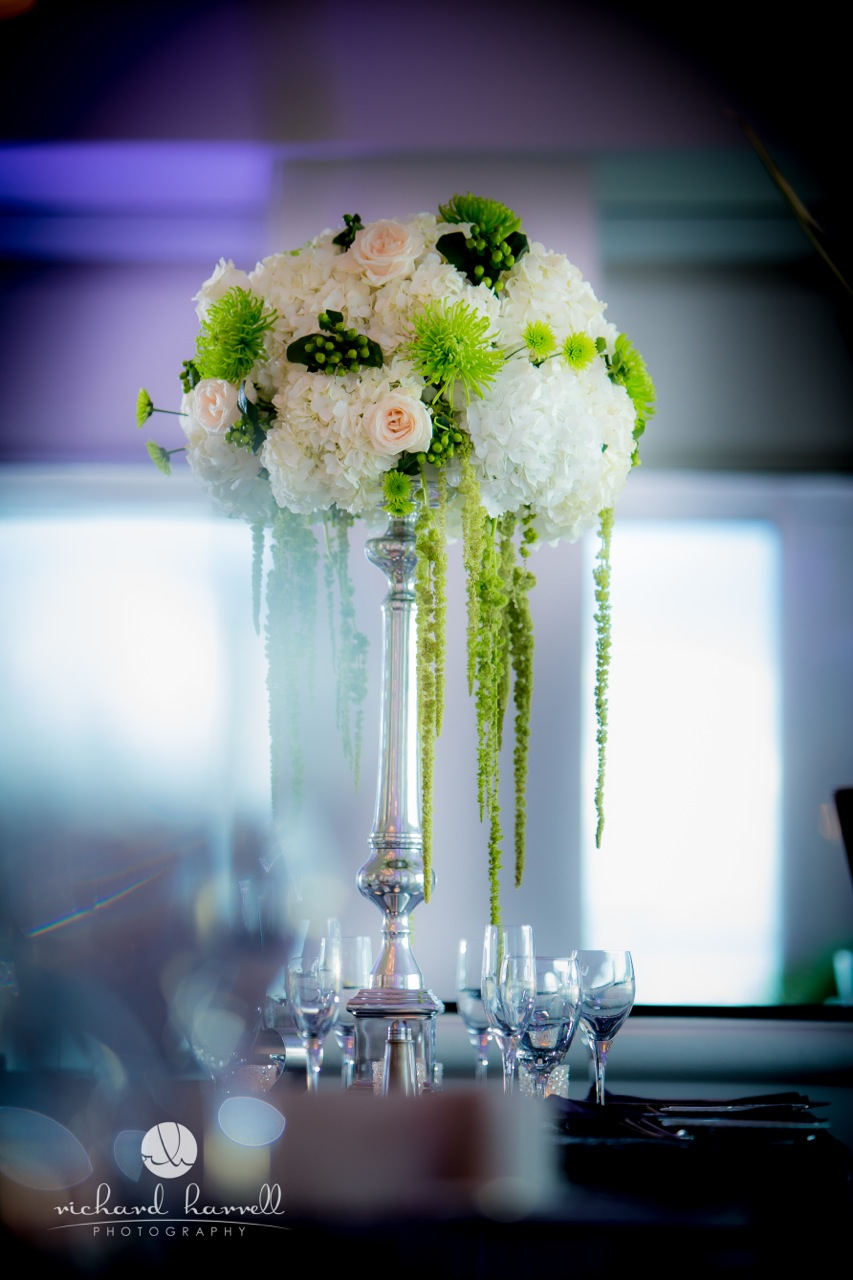 Tall green and white centerpieces