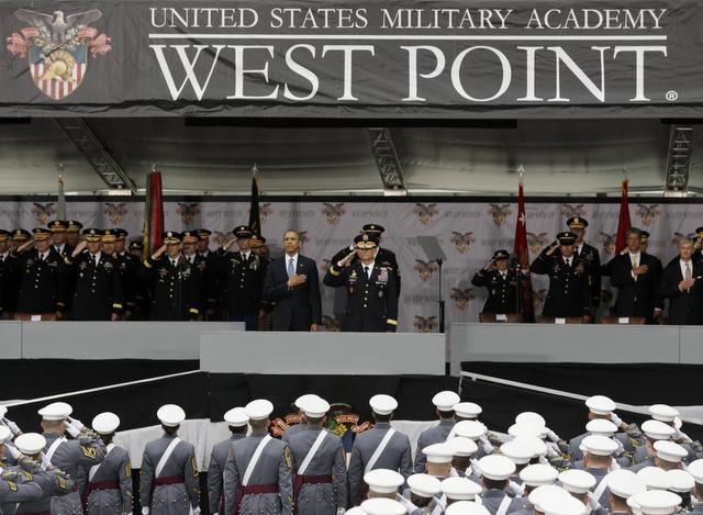 President Barack Obama and Lt. Gen. Robert Caslen Jr.  , center, superintendent at the U.S. Military Academy, stand for the national anthem during last week's graduation and commissioning ceremony in West Point, N.Y. Obama urged restraint before further military missions.