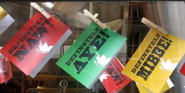 """Jill Lawless/ The Associated Press  Cards hang in a shop in Edinburgh, Scotland, saying """"No,"""" """"Yes"""" and """"Maybe"""" for the upcoming vote on Scotland's independence from the United Kingdom. Scottish voters will decide whether their country should become independent, breaking up Great Britain as it has existed for 300 years."""