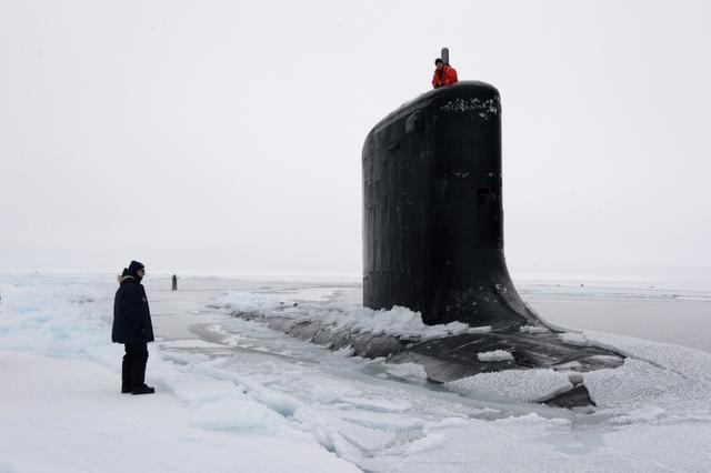 The submarine USS New Mexico   surfaces through the ice during a Navy exercise in the Arctic Ocean last month. Scientists predict that Arctic ice could melt enough to allow for commercial shipping year round. The U.S. is one of many countries with claims in the Arctic.