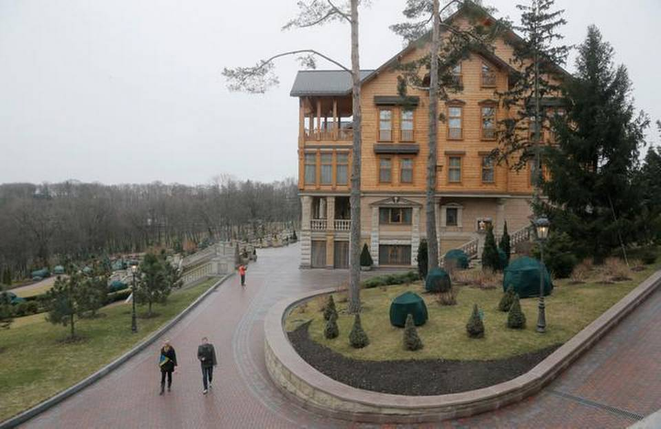 "People walk in the grounds of Ukrainian President Viktor Yanukovych's countryside residence in Mezhyhirya, Kiev region, Ukraine, in 2014. Nothing in the political world says ""kick me"" more loudly than an elected official's huge house. American presidential candidates would do well to heed any warnings that they live lives of excess as this country hurtles toward 2016.     Efrem Lukatsky   Associated Press file."