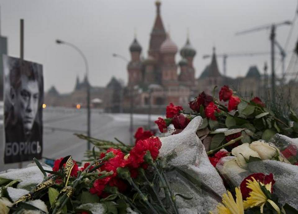 """Flowers and a portrait with the word """"Fight!"""" are displayed Thursday in Moscow at the site near the Kremlin where Boris Nemtsov, a charismatic Russian opposition leader and sharp critic of President Vladimir Putin, was gunned down Feb. 27.     Alexander Zemlianichenko   The Associated Press"""