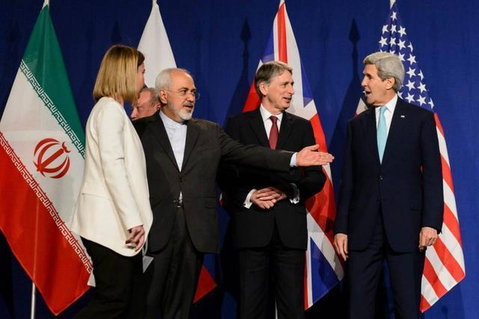 This round of nuclear talks with Iran was conducted in American English under the guidance of U.S. Secretary of State John Kerry, right, a Yale graduate, and Iran's Foreign Minister Mohammad Javad Zarif, second from left, who graduated from San Francisco State and the University of Denver.     Jean-Christophe Bott   Keystone