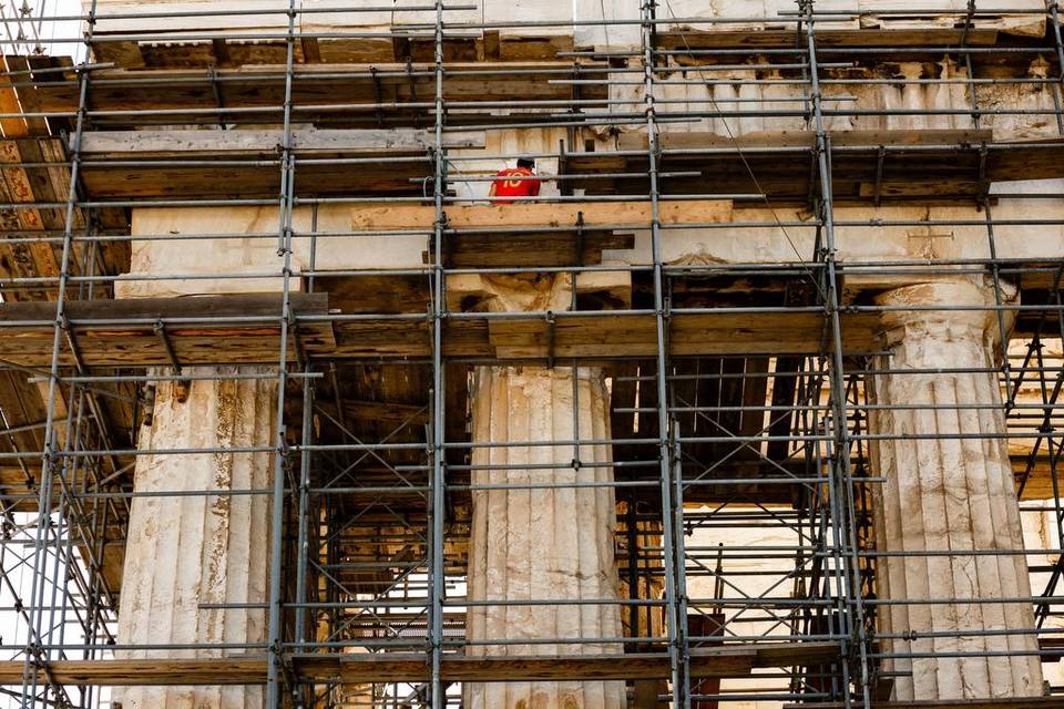 A man works at the Parthenon on Acropolis Hill in Athens, Greece, on Wednesday.| Daniel Ochoa de Olza Associated Press