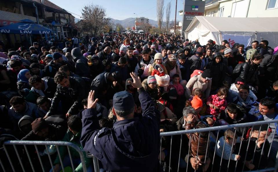 A police officer organizes a throng queuing to get registered at a refugee center in the southern Serbian town of Presevo. Middle East refugees should be invited to join a new military force and given the training, resources and support needed to defeat Islamic State and liberate their homelands. Darko Vojinovic The Associated Press