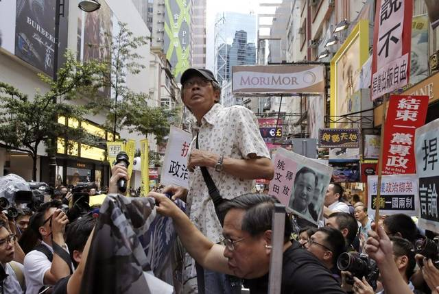 Freed bookseller Lam Wing-kee speaks to pro-democracy protesters in front of his book store in Hong Kong on June 18. He says he spent months in detention by mainland Chinese authorities for books critical of China's Communist leadership. Kin Cheung The Associated Press