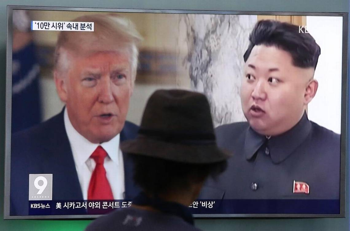 In this Thursday, Aug. 10, 2017, file photo, a man watches a television screen showing U.S. President Donald Trump, left, and North Korean leader Kim Jong Un during a news program at the Seoul Train Station in Seoul, South Korea. North Korea has announced a detailed plan to launch a salvo of ballistic missiles toward the U.S. Pacific territory of Guam, a major military hub and home to U.S. bombers. If carried out, it would be the North's most provocative missile launch to date. Ahn Young-joon AP