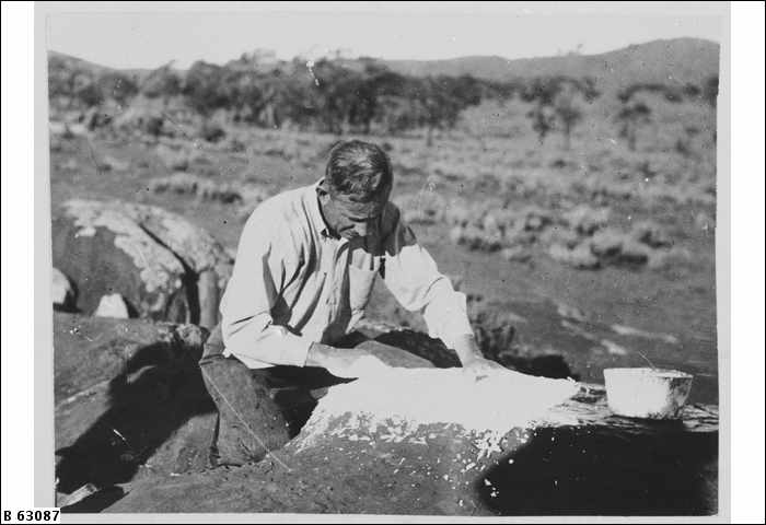 C. P. Mountford, anthropologist, photographed working on location at Panaramitee, South Australia.