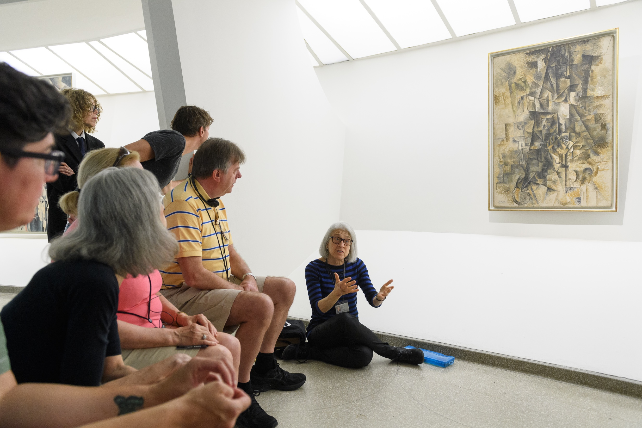A One Hour, One Object tour led by educator Missy Lipsett (seated on the floor) focusing on Pablo Picasso's   Accordionist  .