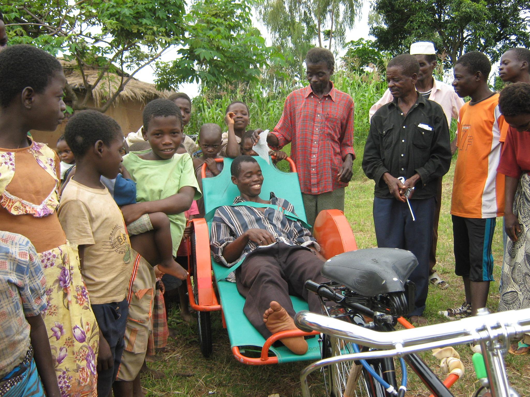 A local patient in Malawi, Africa, getting transported to medical care.