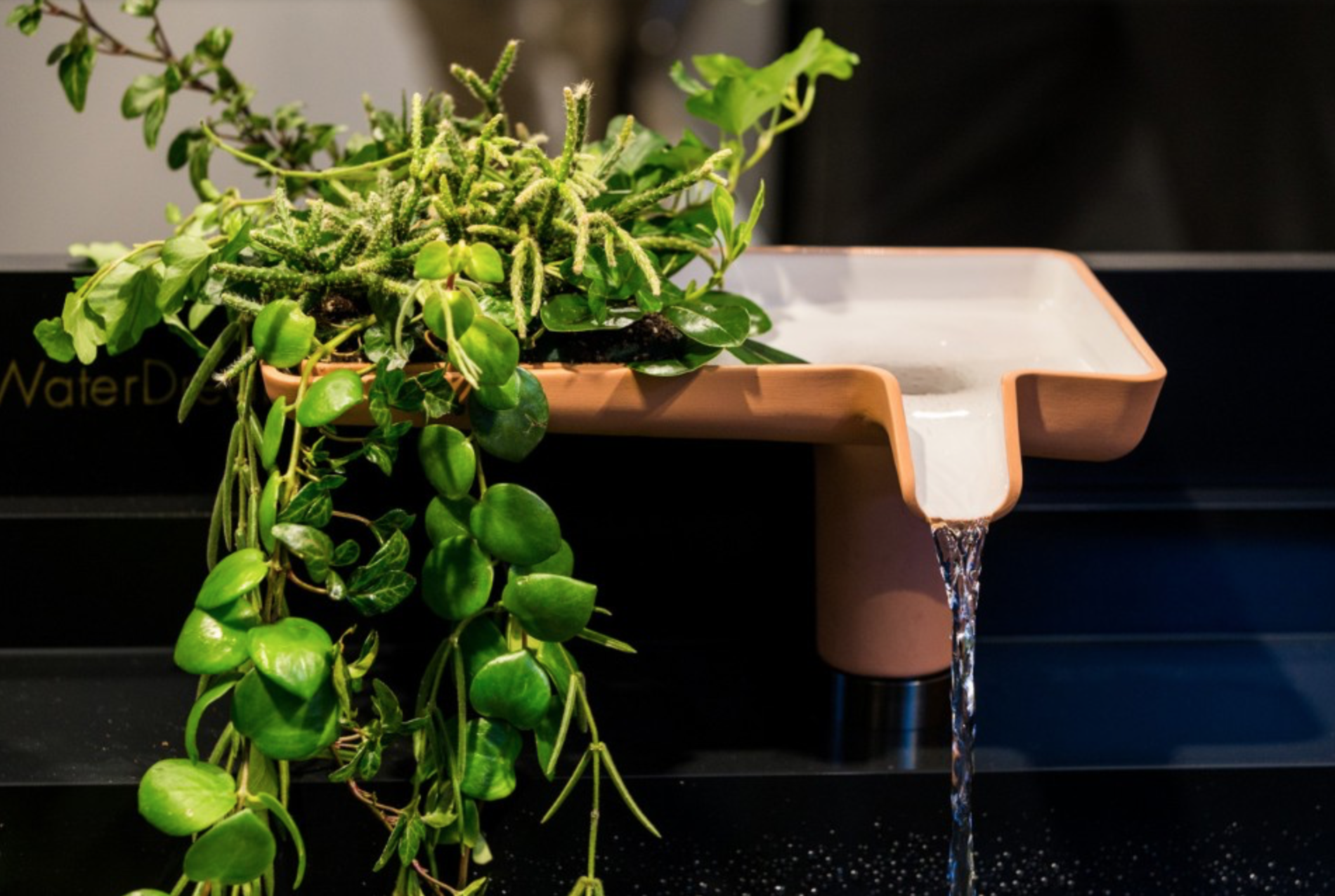 Ceramic faucet with greenery