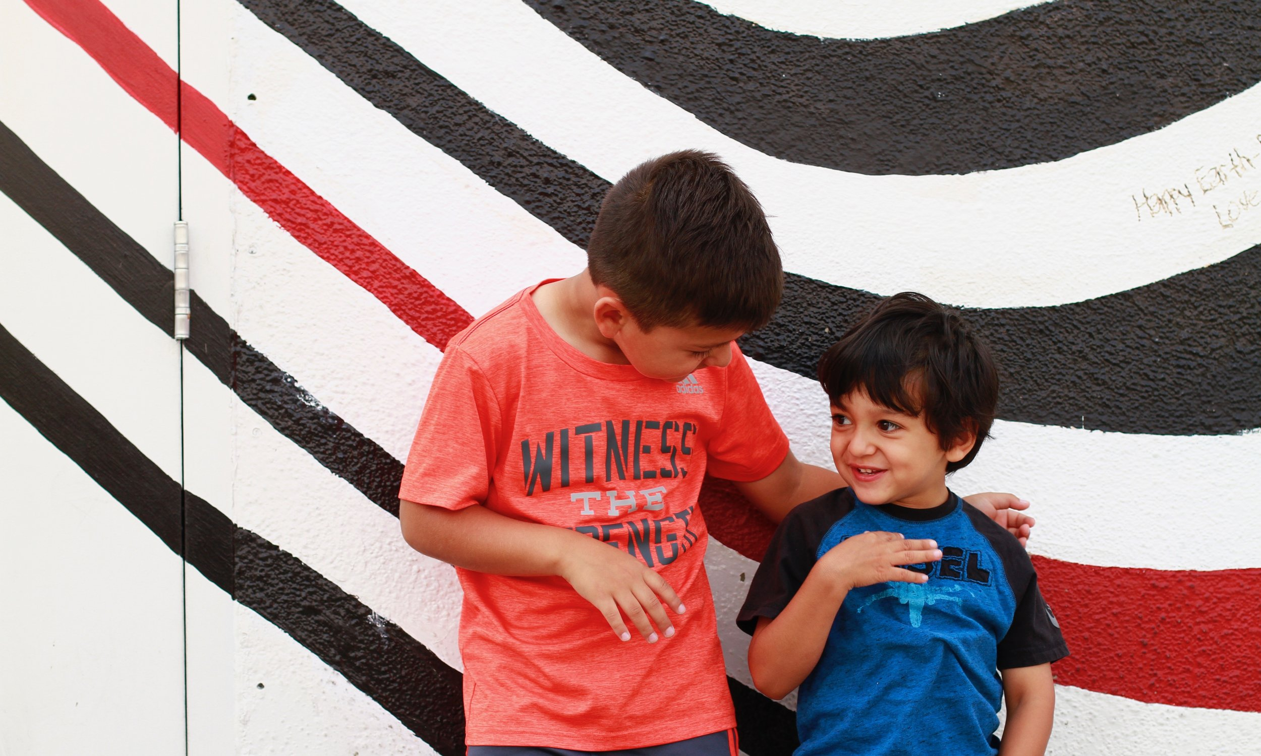 Our sons Samuel (left) and Joseph share a moment in front of the Elliott Smith tribute wall in Los Angeles, CA.