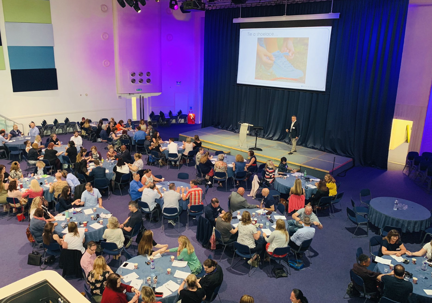 delivering a keynote speech to a conference of 200 people. Winchester, UK, July 2019