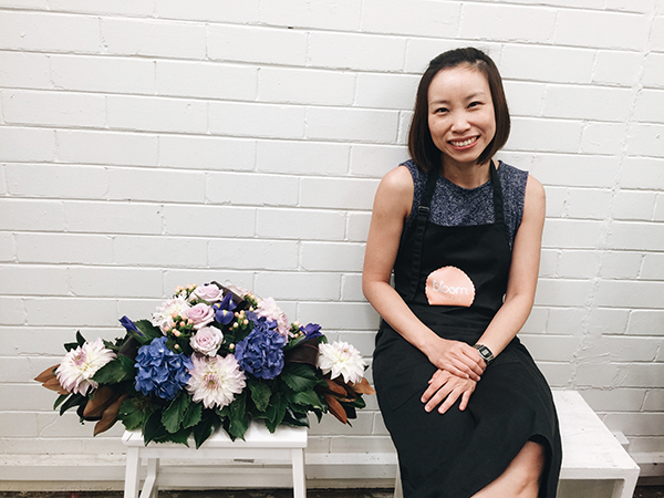 Grace Tay with her creation of a flower bouquet