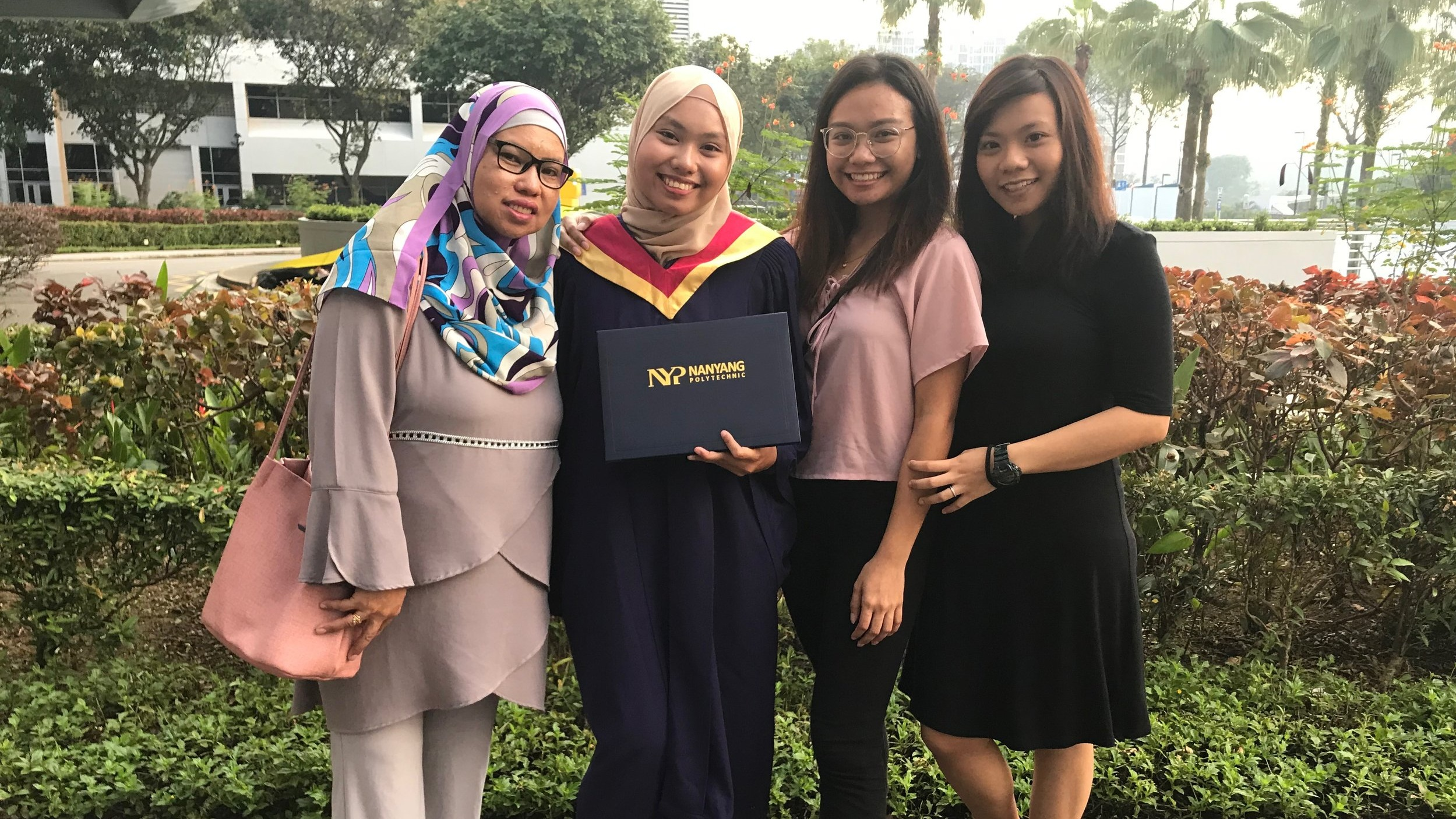 Syarifah (second from left) with her family at her graduation