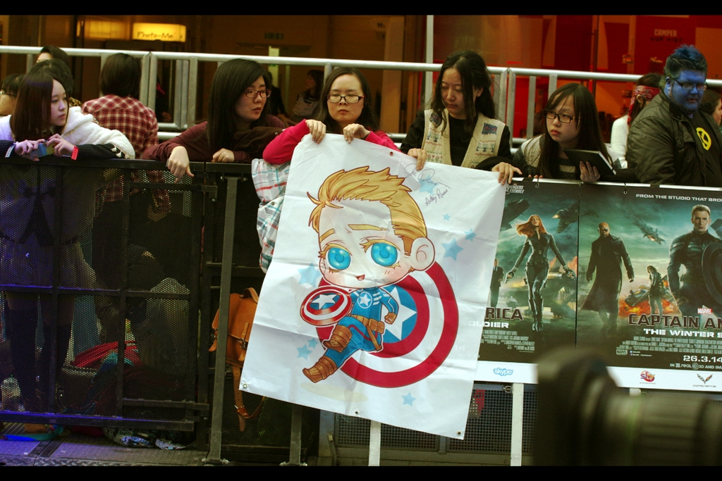 There's probably about another 7 hours of waiting to go, and here's a very kawaii Captain America flag/cartoon. And on the far right side, there's this weird blue-faced dude from the X-Men. (Incidentally, despite being owned by Marvel comics, the X-Men are not allowed to be involved in The Avengers, but it's less a schoolyard 'cool' thing and more an 'our parents' lawyers say I'm not allowed to' thing).