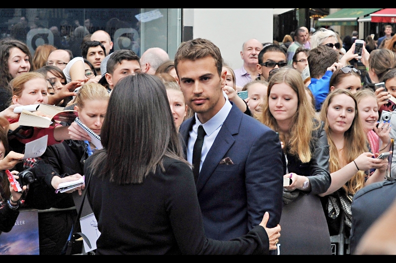Good news. If that screaming you're hearing is coming from you and you're female, that means you've just realised that Theo James has entered your part of the crowd. I assume he plays whatever role Liam Hemsworth plays in The Hunger Games in this movie.