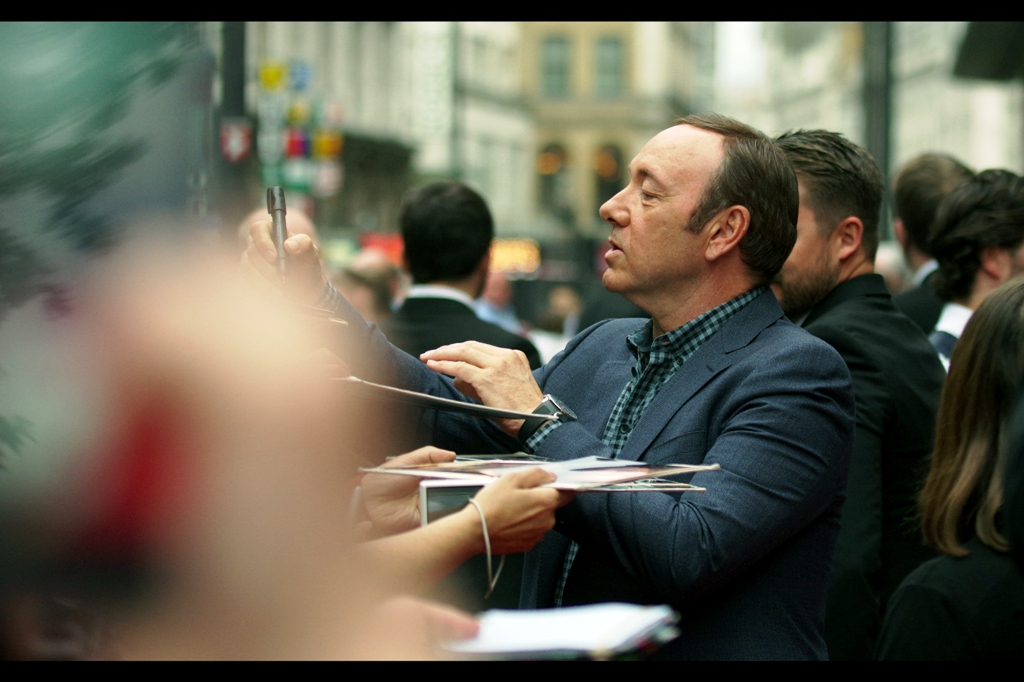 When Al Pacino signs autographs, the music in his head is probably heavy metal, but for Kevin Spacey, I'm thinking Bach. Alternatively, it's a special request from the security dude who'll beat up anyone who tries to get Kevin Spacey to sign something from a movie he's not actually in.