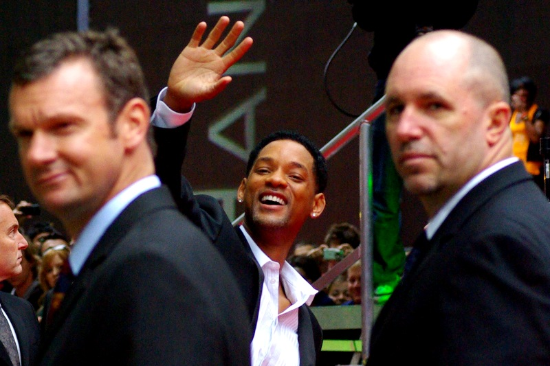 Every time I remind Will Smith that he still owes me five dollars, this is the response I get... him hiding behind his bodyguards and waving.(Also : OMG - eye-contact from Will Smith. What do I win? Do I win anything? Can I get a high-five too?)