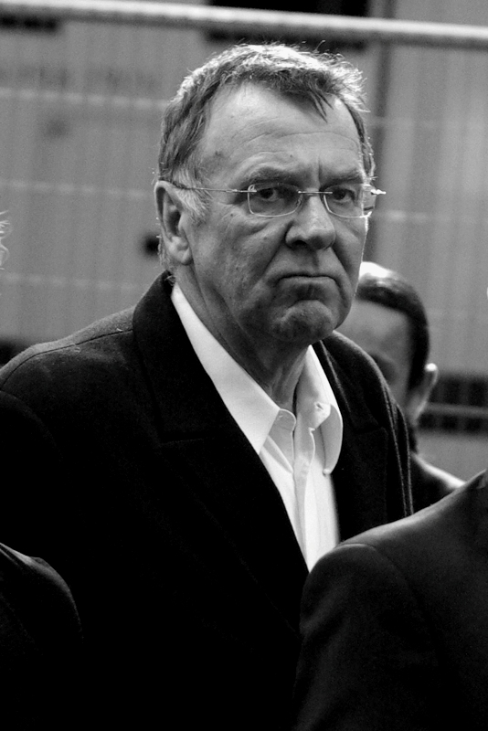 Tom Wilkinson. Aka Gotham City Crime Boss Falconio in 'Batman Begins'. He also owes me $5, but just for once I'm willing to waive it. As a favour.