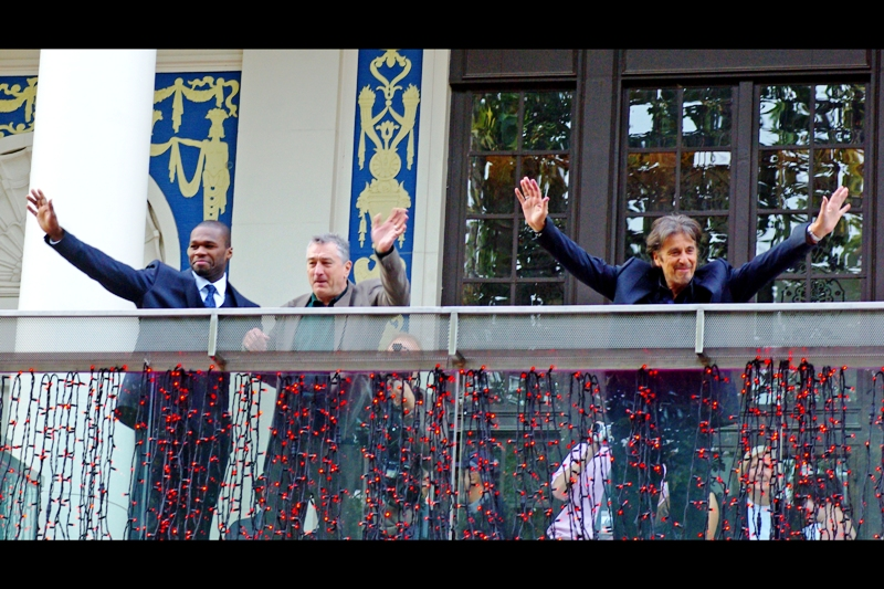 """""""HUZZAH!! We're famous and get a balcony while you people get crushed behind barriers voluntarily on a weekend to see us wave at you!!""""  Well... when you put it like that it's a whole lot less glamorous.."""