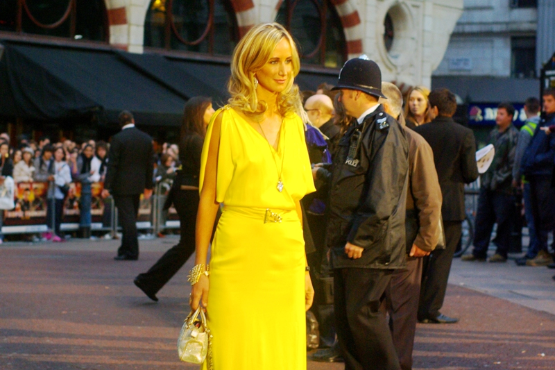 Exceedingly thin, slightly jaundiced and wearing a searingly yellow dress. My camera's autofocus seized up a little trying to find the contrast there. My main thought: eat a cough drop, lady- you need the calorie!