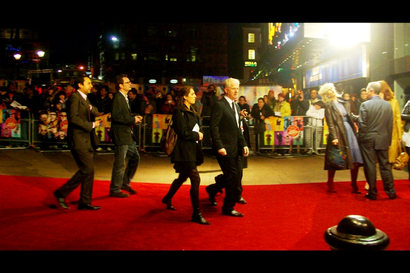This photo of director Richard Curtis (who also wrote and directed 'Love Actually' as well as having numerous writing credits) is fairly cool in its own right, but the lady having a pseudo-religious experience on the red carpet to his right kind of wins it for me. (she didn't actually fall, she just kind of... leaned...)