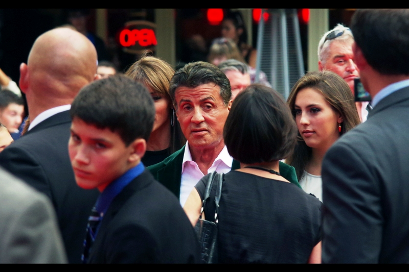 Fittingly, our first arrival is The Main Guy - Sylvester Stallone himself. He wrote and directed Rocky and starred in it, he's been Rambo, he conceived of The Expendables.... he was even in Stop! Or My Mom Will Shoot. In all respects he's earned the right to wear a green-jacked suit to an Expendables III premiere. I'll be showcasing more of it in this journal... it's quite spectacular(ish)