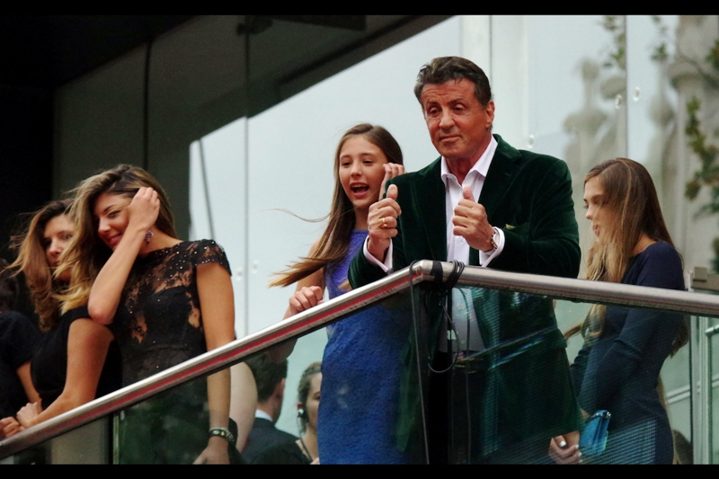 Sylvester Stallone has retired to the public comfort (and no doubt spectacular views) of the premiere as afforded by the Odeon Leicester Square balcony. Life? Appears to be good when your suit is green and your movie is having a London World Premiere.