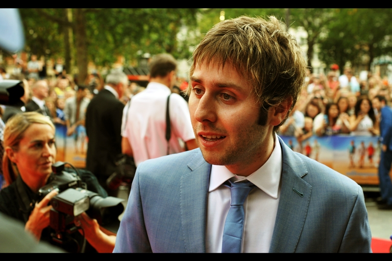 Similarly, James Buckley is also best known for being in The Inbetweeners Movie, The Inbetweeners TV Show and the Inbetweeners movie sequel. Oh, and a movie starring Shia LaBeouf, who is now best known for putting paper bags over his head and crying as a piece of installation art. So... you know... keep an eye on the tie. Once it comes off, he could go off the rails handily.