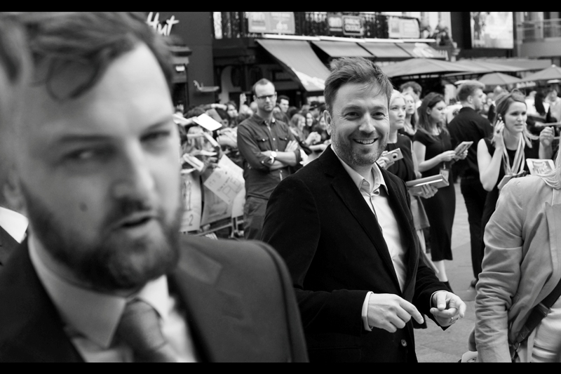 """""""You're absolutely right. I AM one of the two directors of this film, and the more handsome and talented on as well. Wait... the other guy isn't behind me, is he?"""" Damon Beesley (foreground) correctly anticipates the arrival of Iain Morris)."""
