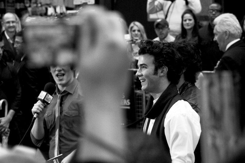 One of the Jonas Brothers, with an *actual* twinkle in his eyes. (Disney executives high-five each other)