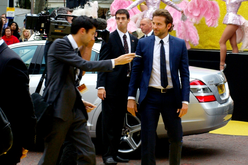 I'm not sure what's going on, but I suspect actor Bradley Cooper has been approached by a scalper to purchase tickets to his own premiere.