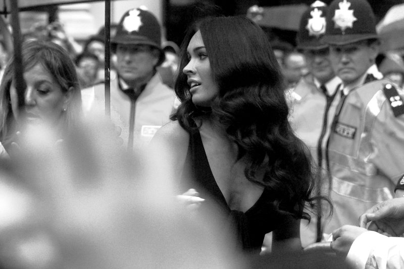 Once again, actress (or should I say Walking Magazine Cover) Megan Fox. The black and white conversion in this photo is due to the distractingly yellow jackets of the police in the background, in case you're reading the commentary instead of looking at the photo. Can one photo make a whole premiere worthwhile? Given the unforgivable autofocus issues to come in this journal, I'm saying yes.