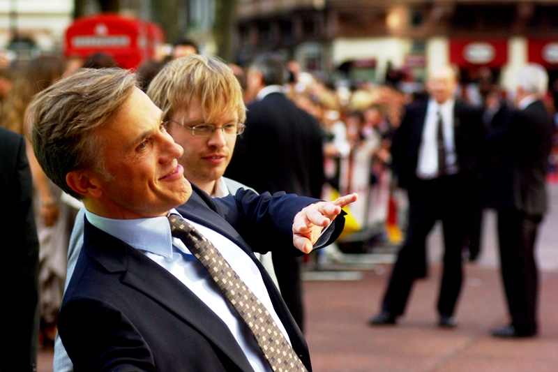 Actor Christoph Waltz has arrived, and it looks strangely like he's wearing an oversized mask... of his own face. He plays Captain Hans Lander in the film.