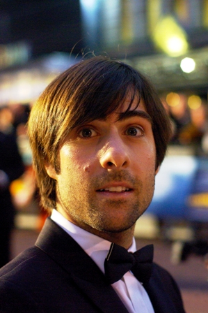 This is Jason Schwartzman. I had to check IMDB to find out why he looked familiar but not quite like the guy from the American Pie films, which he's not in. But the hairstyle and bow tie are clearly top-notch. (ps. he's excellent in the later-released Scott Pilgrim vs the World)