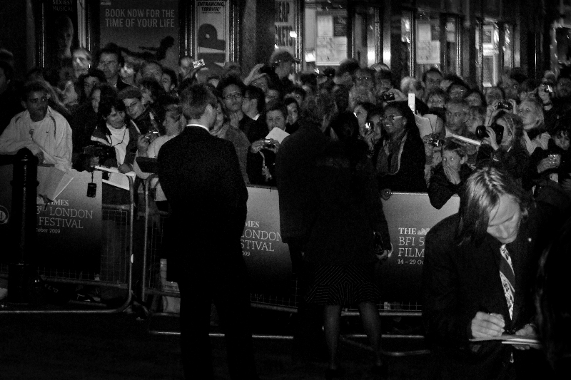 (Foreground, right) Actor Viggo Mortensen (Lord of the Rings, A History of Violence) diligently signs autographs for fans at the gala screening. Another difference between a premiere and a gala screening is that the Red Carpet is narrower, can wind around the outside of a building while cars park behind the cinema, and stars go in one side of the cinema entrance while 'normos' can go in via another one.
