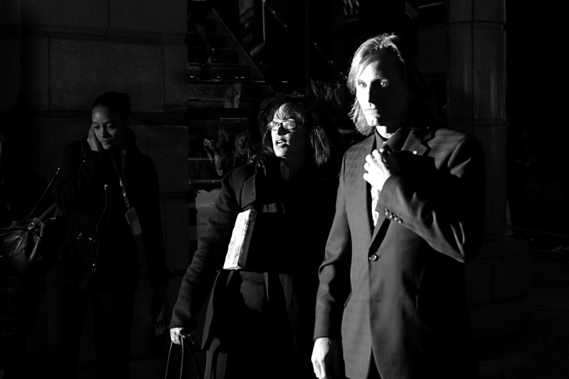 But if you're lucky with the incidental lighting, you can get lucky and extract an interesting shot Like here, where Viggo looks demonic, the lady next to him has seen something even scarier than Viggo, while the third lady? Eh... just calmly calling somebody. A priest perhaps.