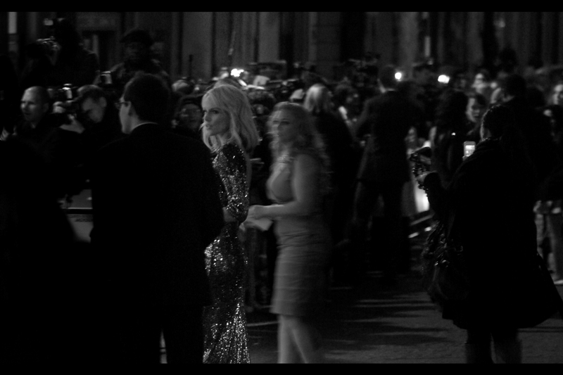 If I could have better-exposed just ONE photo I took at this premiere, it would be this one. Monet Mazur is looking very 'leading lady-esque' being led to the double wall o'paps.
